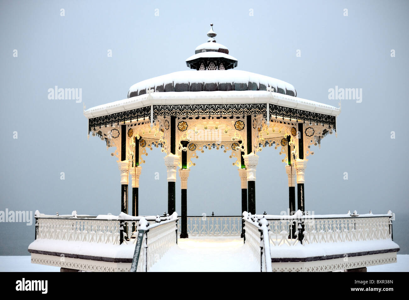 A Victorian bandstand covered in snow - Stock Image