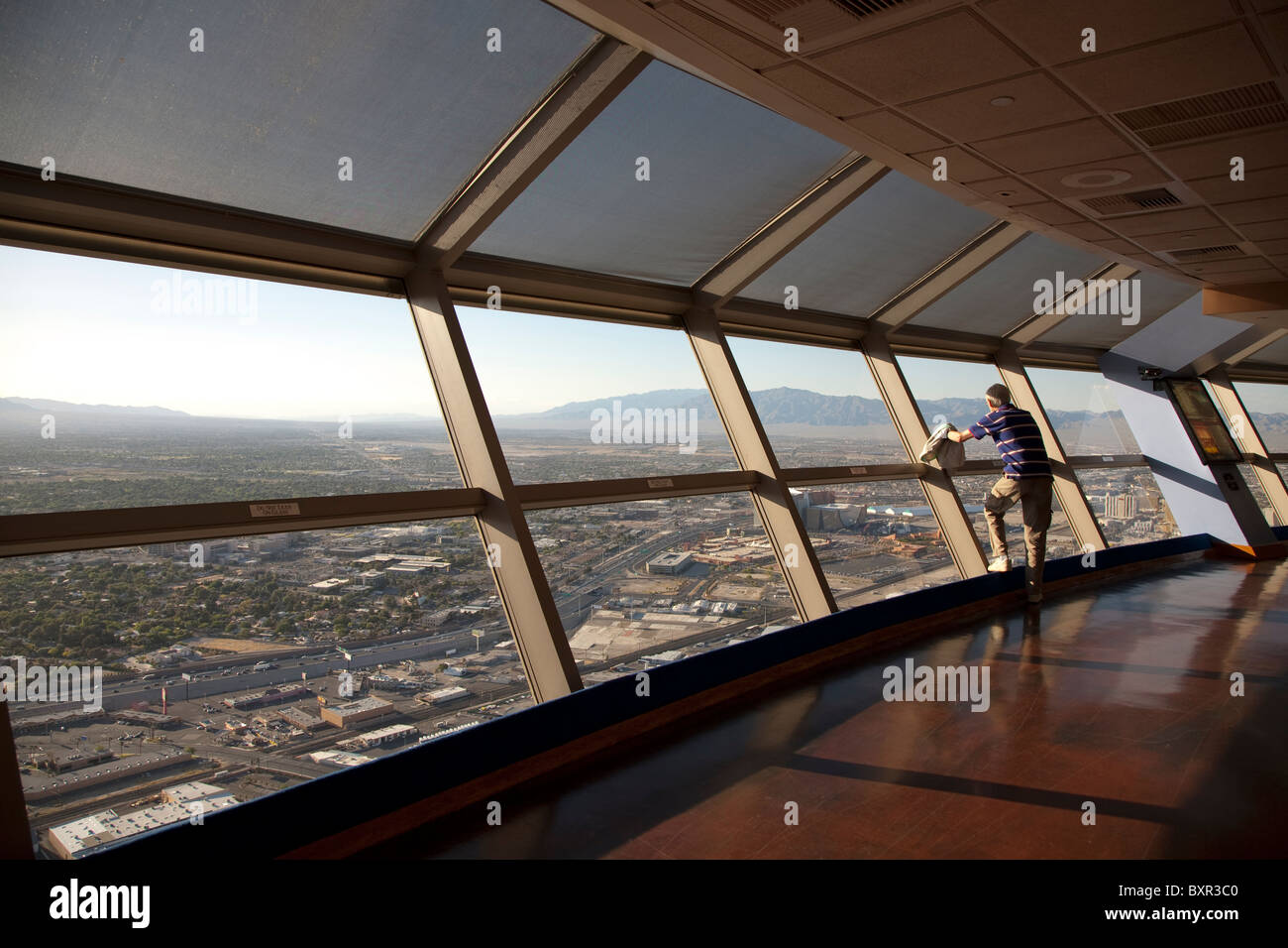Sole tourist on the viewing deck at the top of the stratosphere tower in Las Vegas Nevada USA - Stock Image