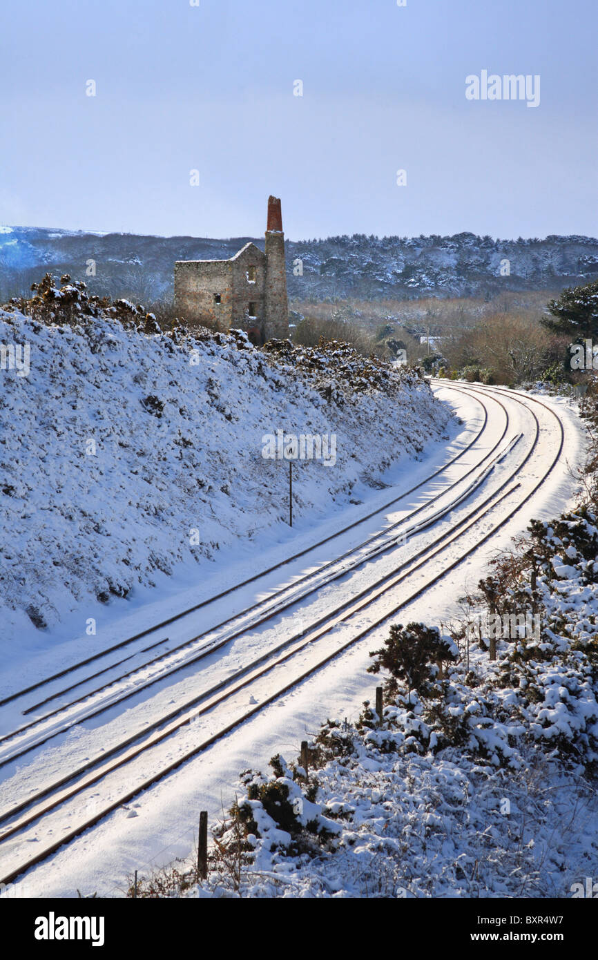 Cornwalls main railway line in the snow.  Captured from a road bridge over the line near Scorrier in mid Cormwall - Stock Image