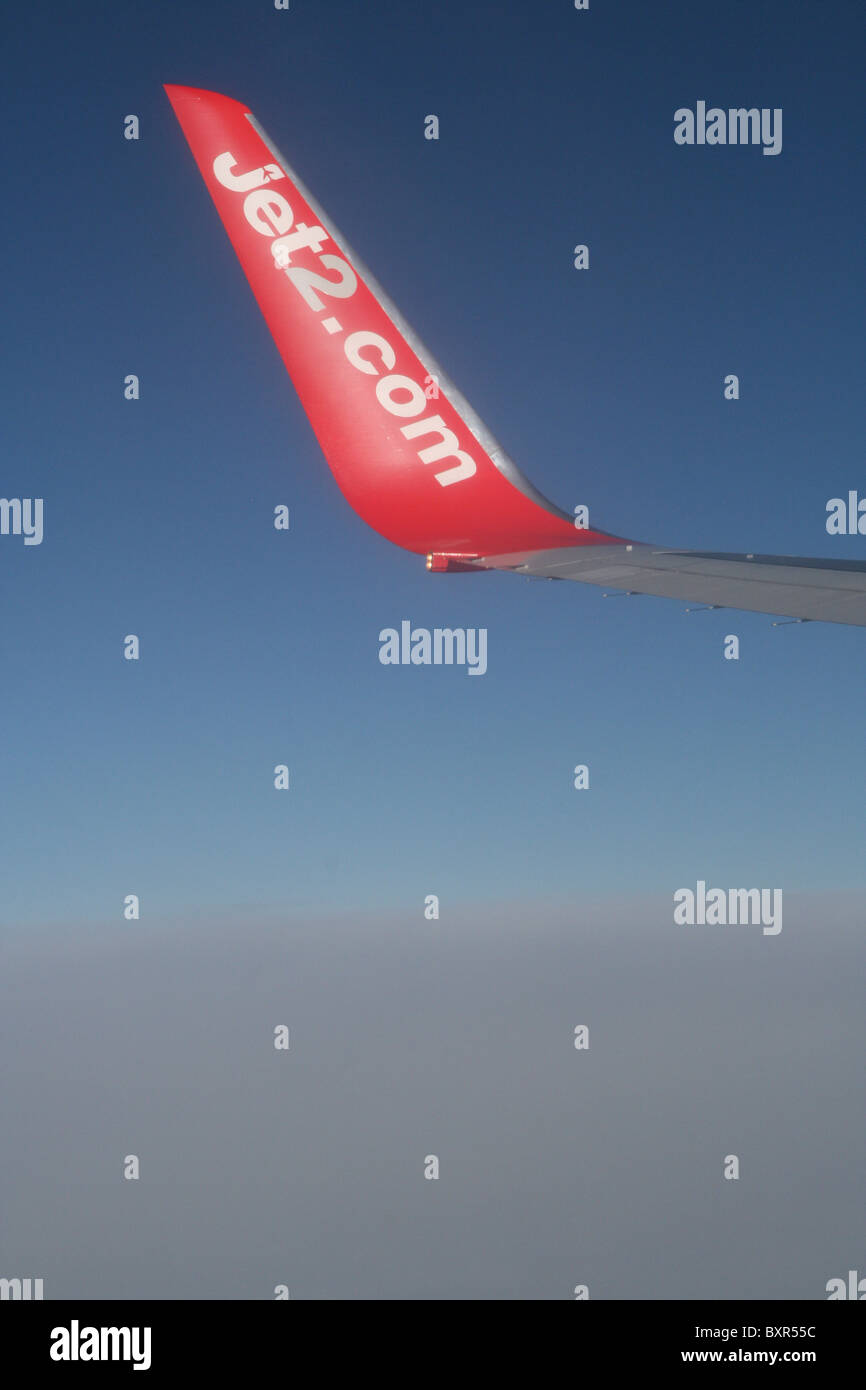 Wingtip of Jet2 757above the clouds - Stock Image
