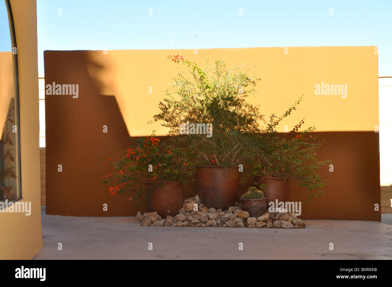 El Paseo, Palm Springs, California. Lighting, potted plants and wall ...