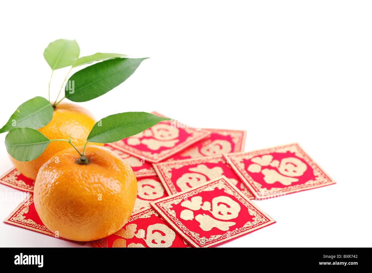 Mandarin oranges and 'Fu' Character,Closeup. - Stock Image