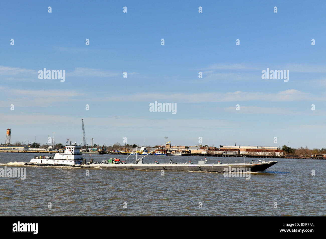 tug pushing barge mississippi river new orleans louisiana stock photo 33702238 alamy. Black Bedroom Furniture Sets. Home Design Ideas