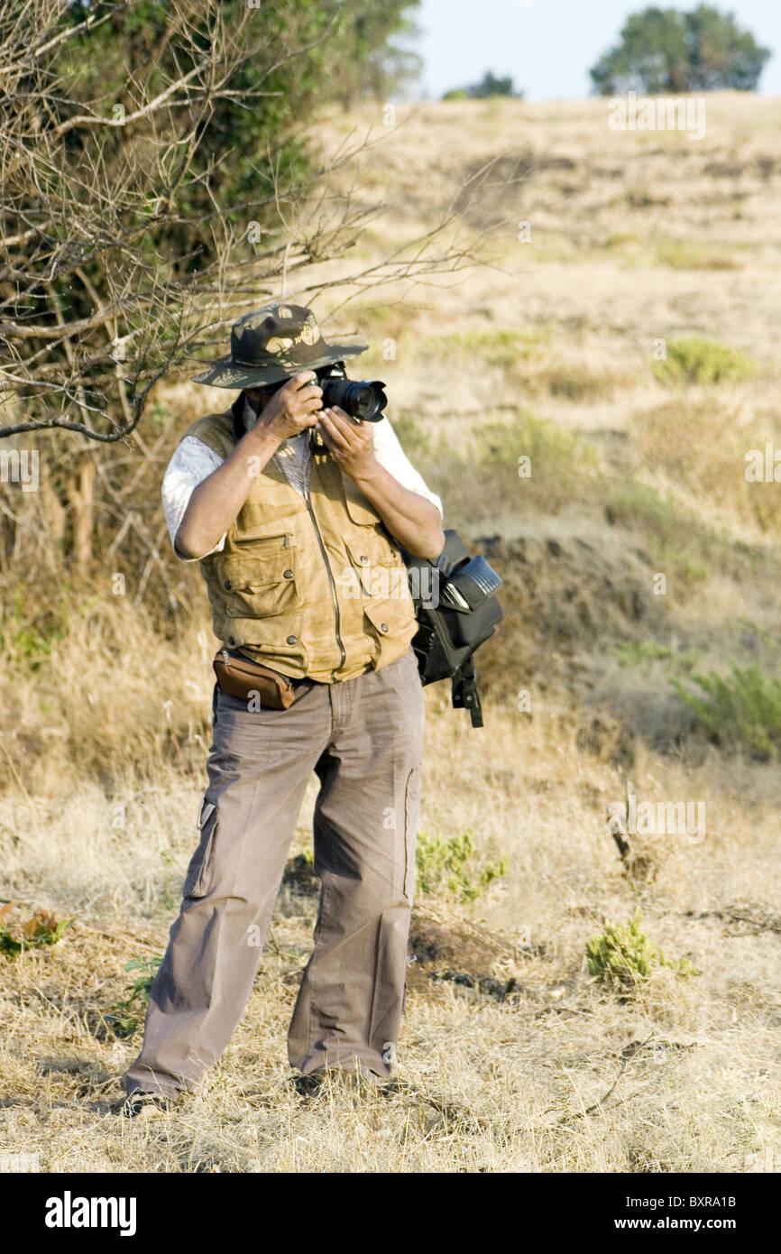 Nature photographer at work. - Stock Image