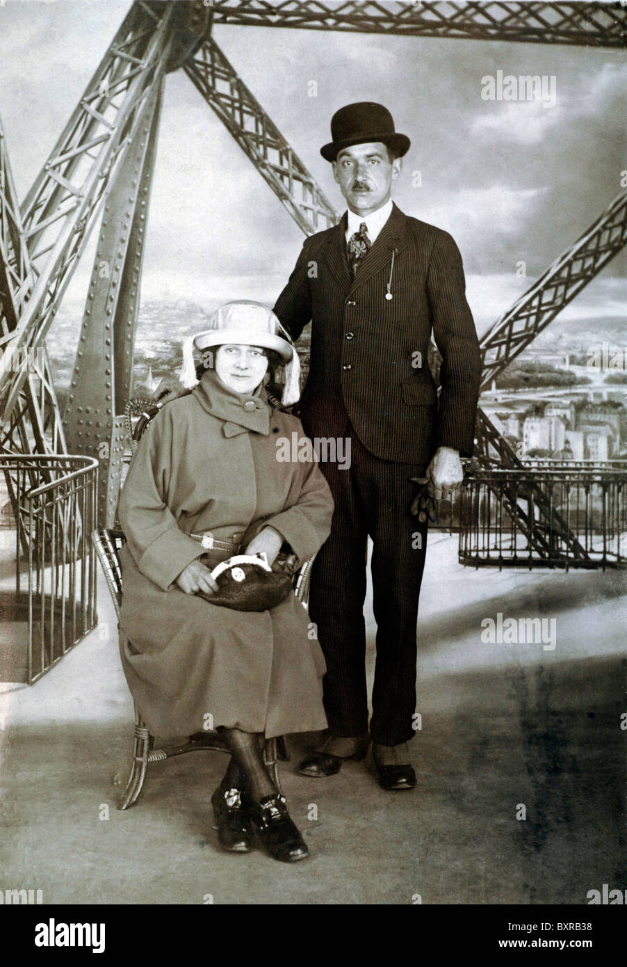 Tourist Couple Photographed on or with the Eiffel Tower in the Background, Paris (c1920-30s) Formal Studio-like - Stock Image