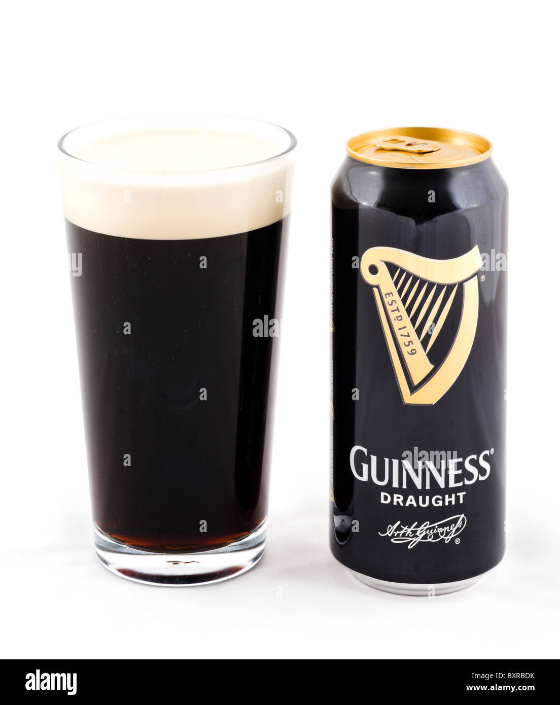 Can and glass of draught Guinness, UK - Stock Image