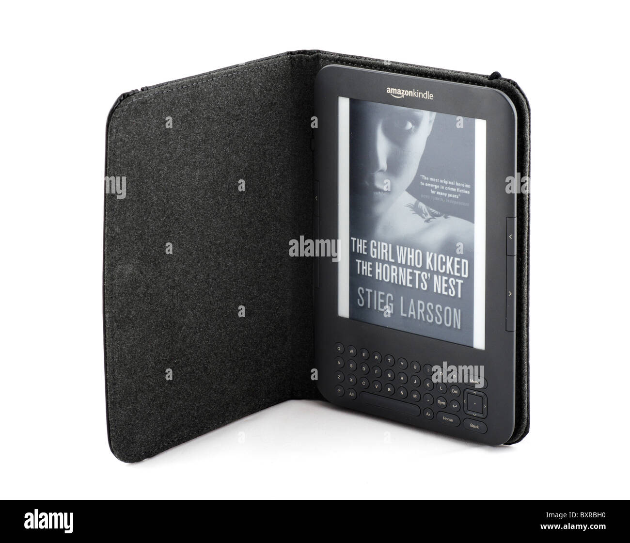 The 2010/11 Amazon Kindle ebook reader in the standard leather cover with a copy of Stieg Larsson best selling trilogy, - Stock Image
