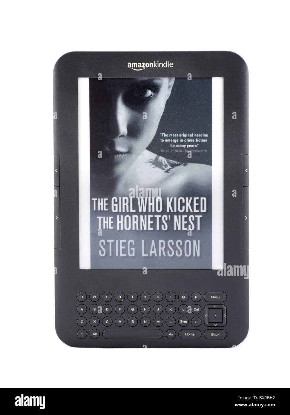 The 2010/11 Amazon Kindle ebook reader with a copy of one of Stieg Larsson's best selling Millennium trilogy, - Stock Image