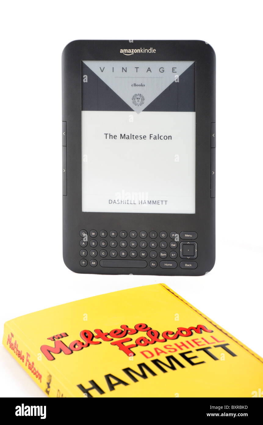 The 2010/11 Amazon Kindle ebook reader and a hard copy of The Maltese Falcon by Dashiell Hammett, UK - Stock Image
