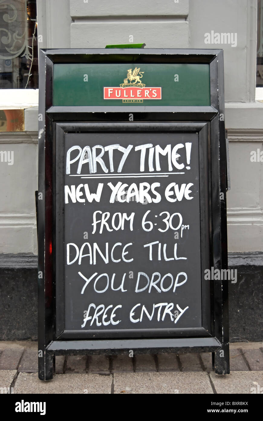 sign outside the surbiton flyer pub, in surbiton, surrey, england, for a new year's eve party - Stock Image