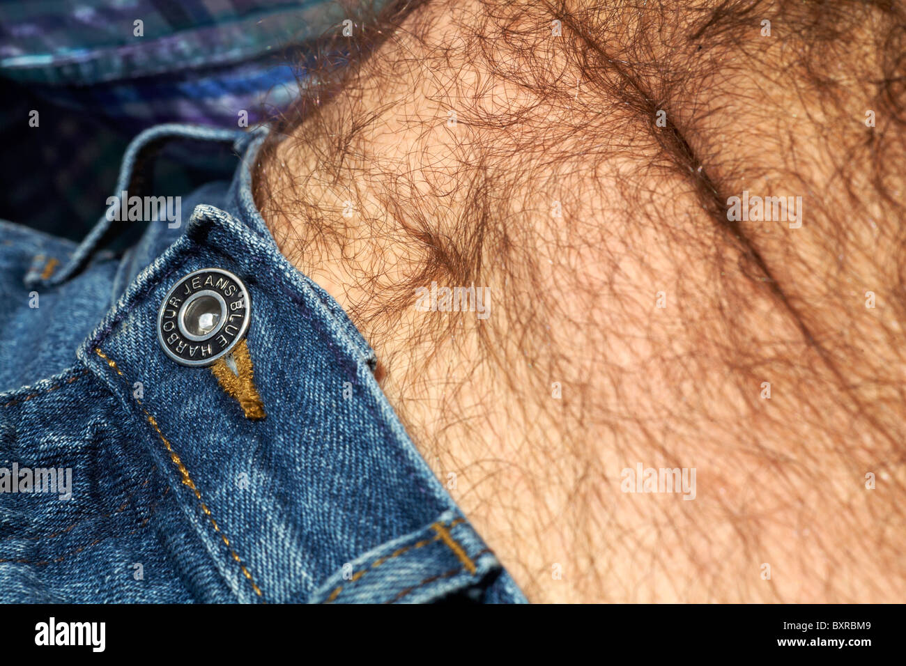 Close up detail of man wearing Blue Harbour Jeans - Stock Image