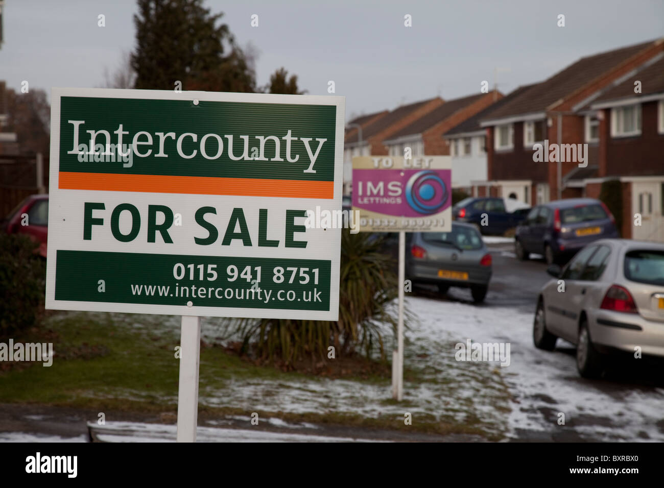 Two for sale signs at neighbouring houses on a residential street in Nottingham England UK - Stock Image