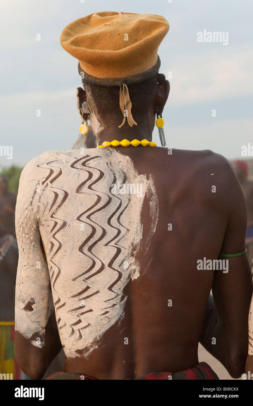Nyangatom (Bumi) man with painted back, Omo river Valley, Ethiopia Africa Stock Photo