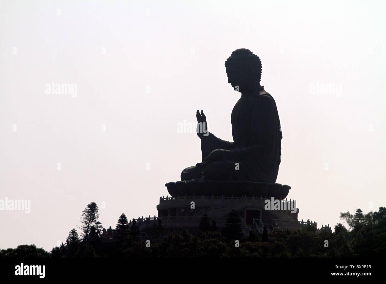 Silhouette of the Tian Tan Buddha statue on Lantau Island in Hong Kong, China - Stock Image