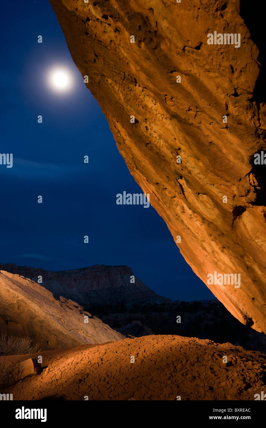 Surreal light painting of rock and landscape with moon at Capitol Reef National Park - Stock Image