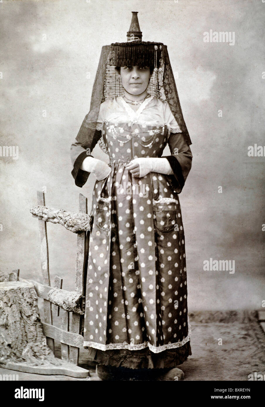 French Woman in Traditional Folklore or Folkloric Costume from Mâcon, Burgundy, Central France (c1900) - Stock Image