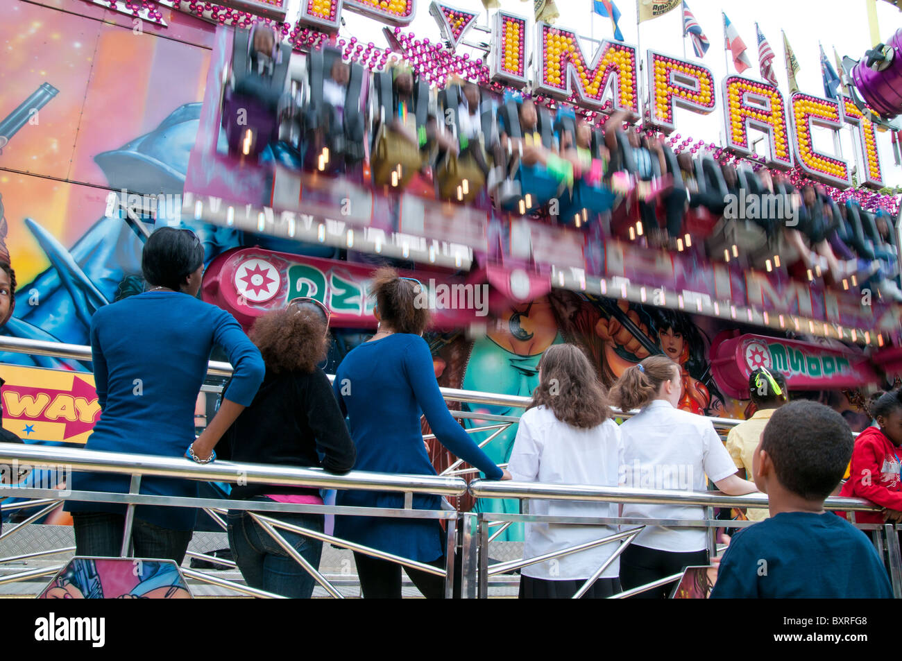 UK. Afro-caribbean and white youth at a funfair in London - Stock Image