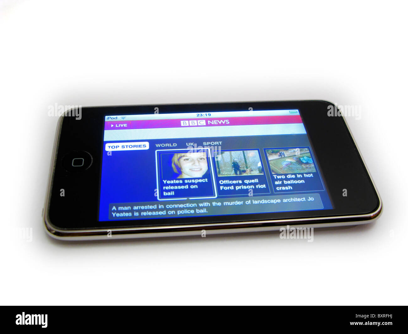 cutout of ipod touch showing bbc news home page Joanna Yeates murder enquiry on white background - Stock Image