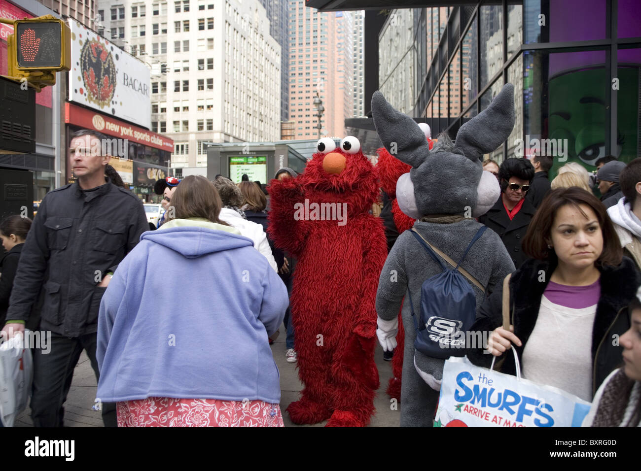 famous kids cartoon characters mix with pedestrians in times square
