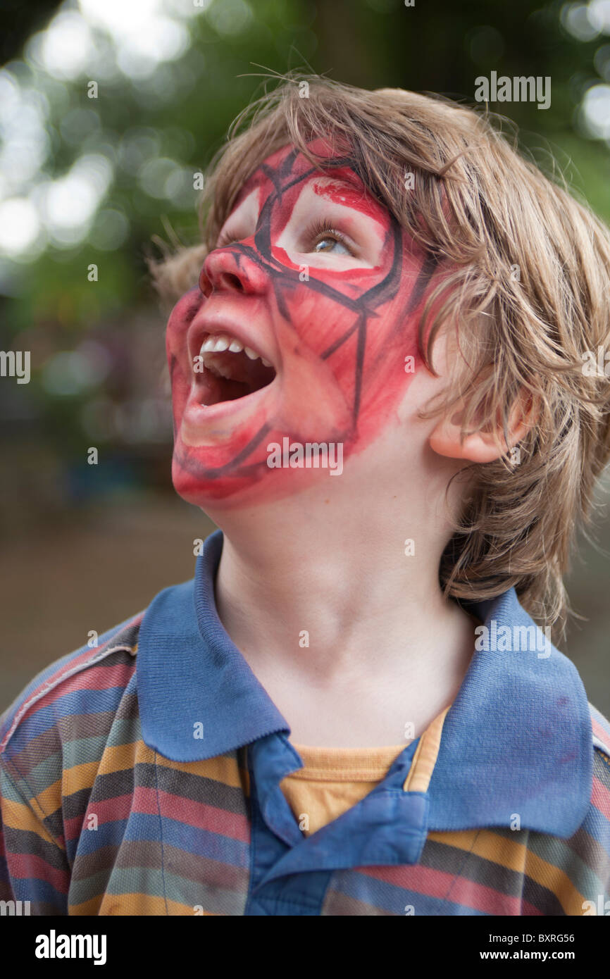 happy boy face painted - Stock Image