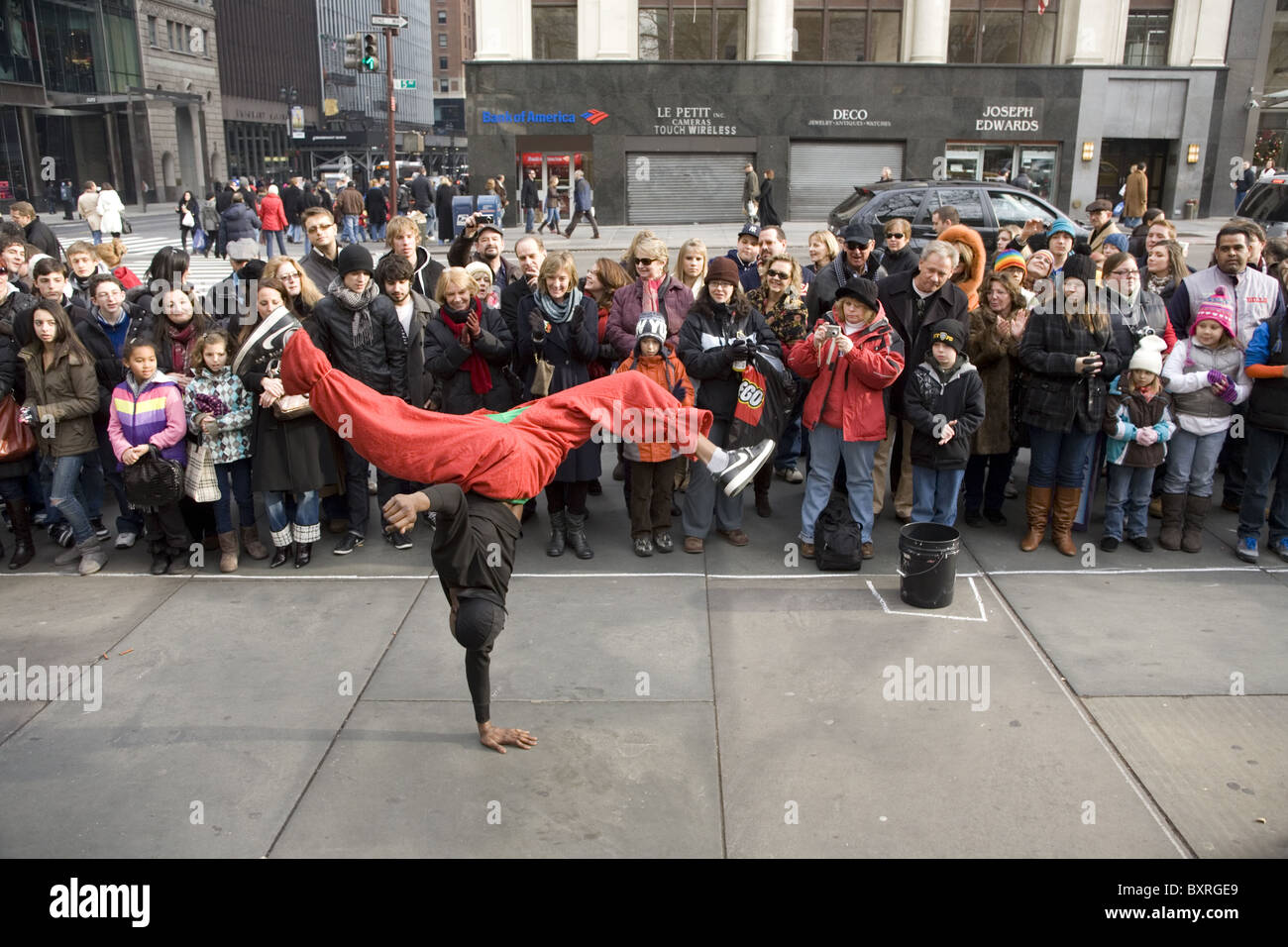 Break Dancers entertain the crowds in front of the NY Public Library on 5th Ave. during the holiday season in NYC. - Stock Image
