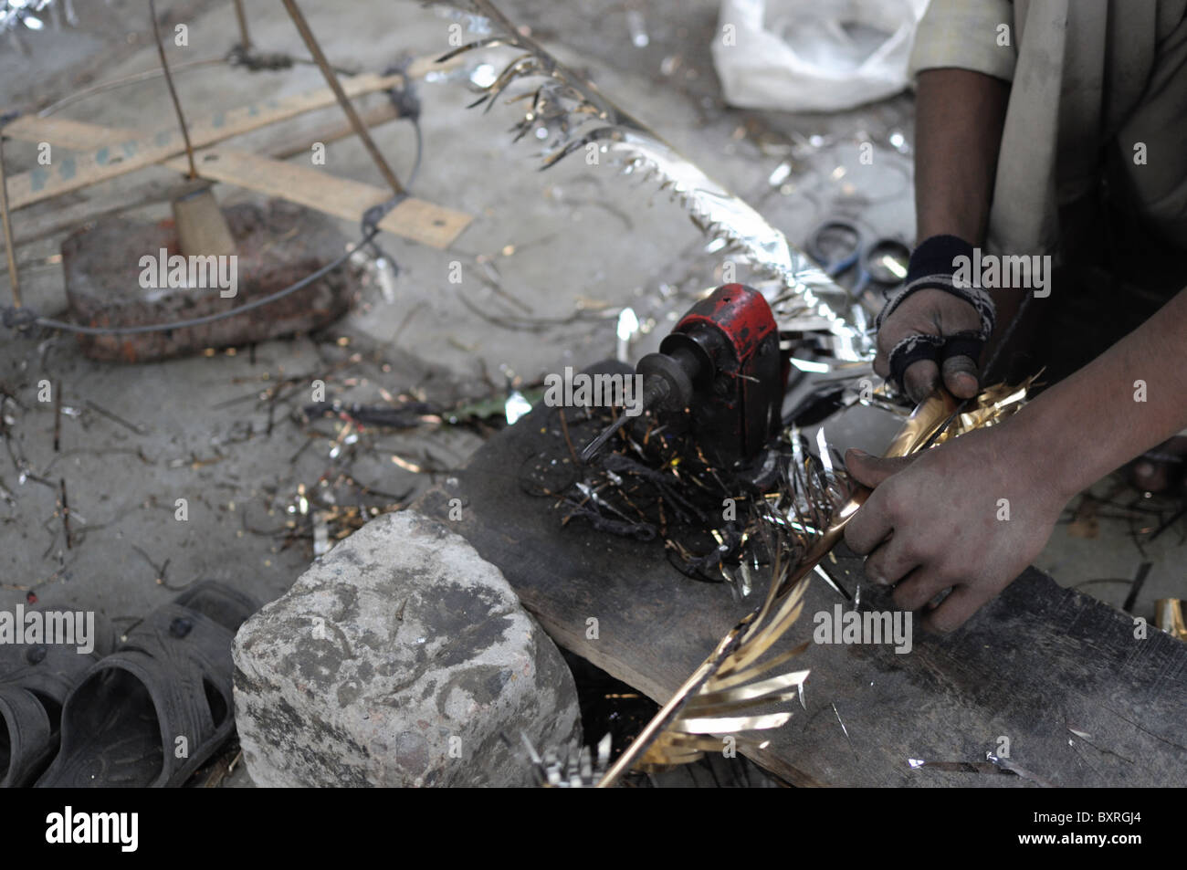 Young boy producing decorations in New Delhi. - Stock Image