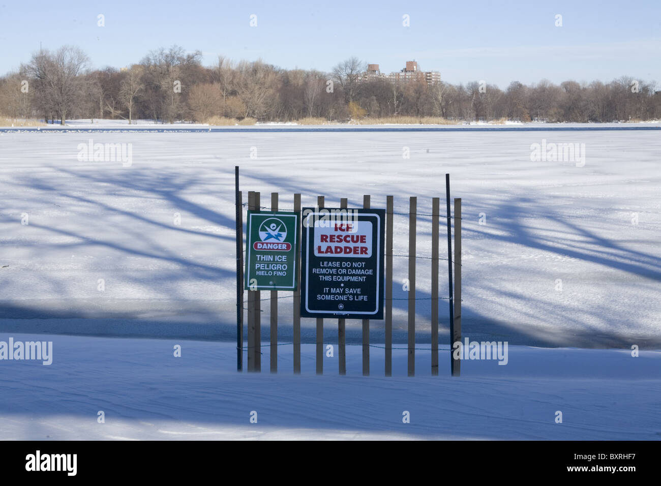 Frozen lake in Prospect Park, Brooklyn, New York with the warning thin ice - Stock Image