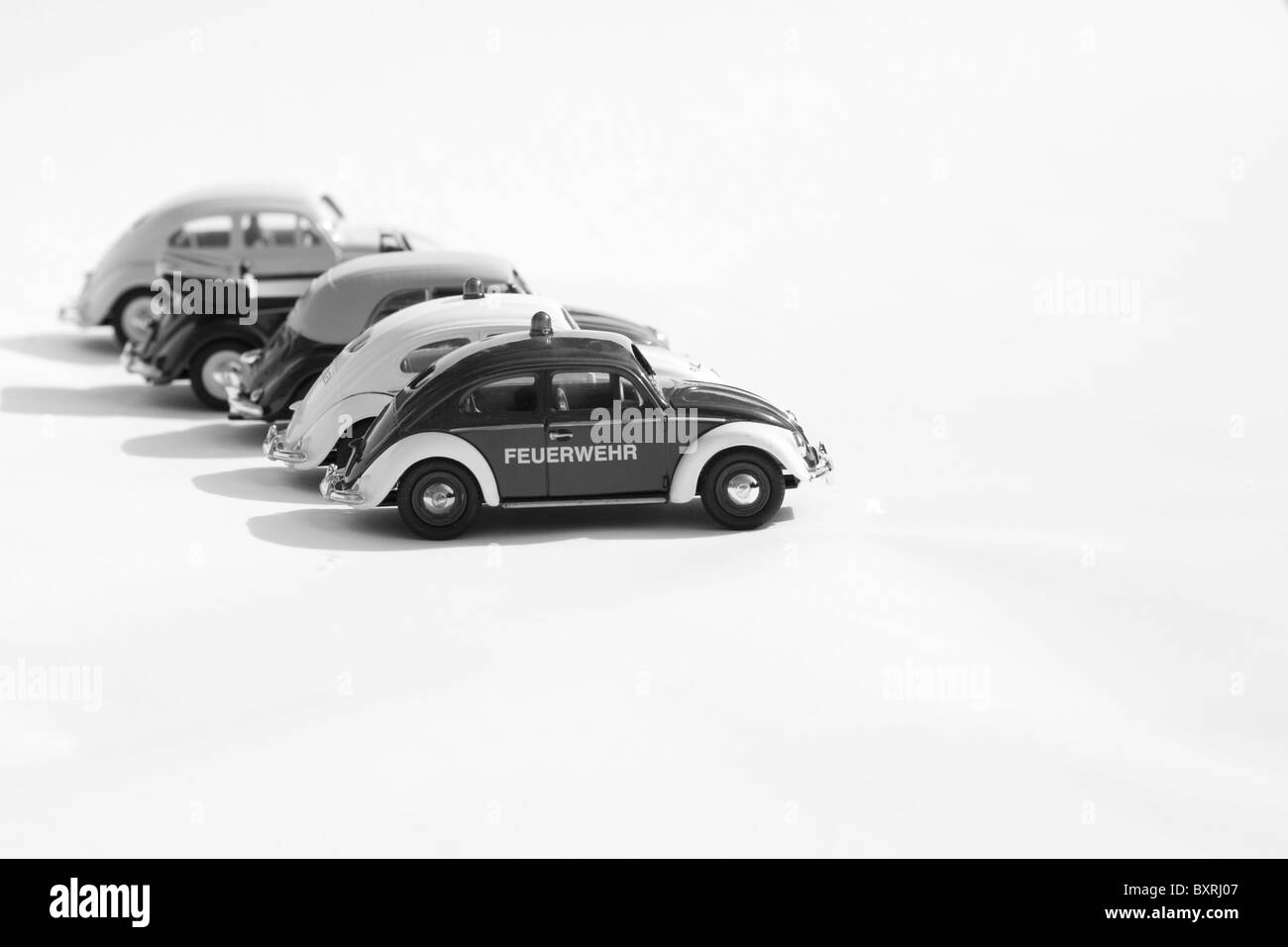 Collectible die cast toy models of Four Volkswagen Beetles cars Black and White - Stock Image