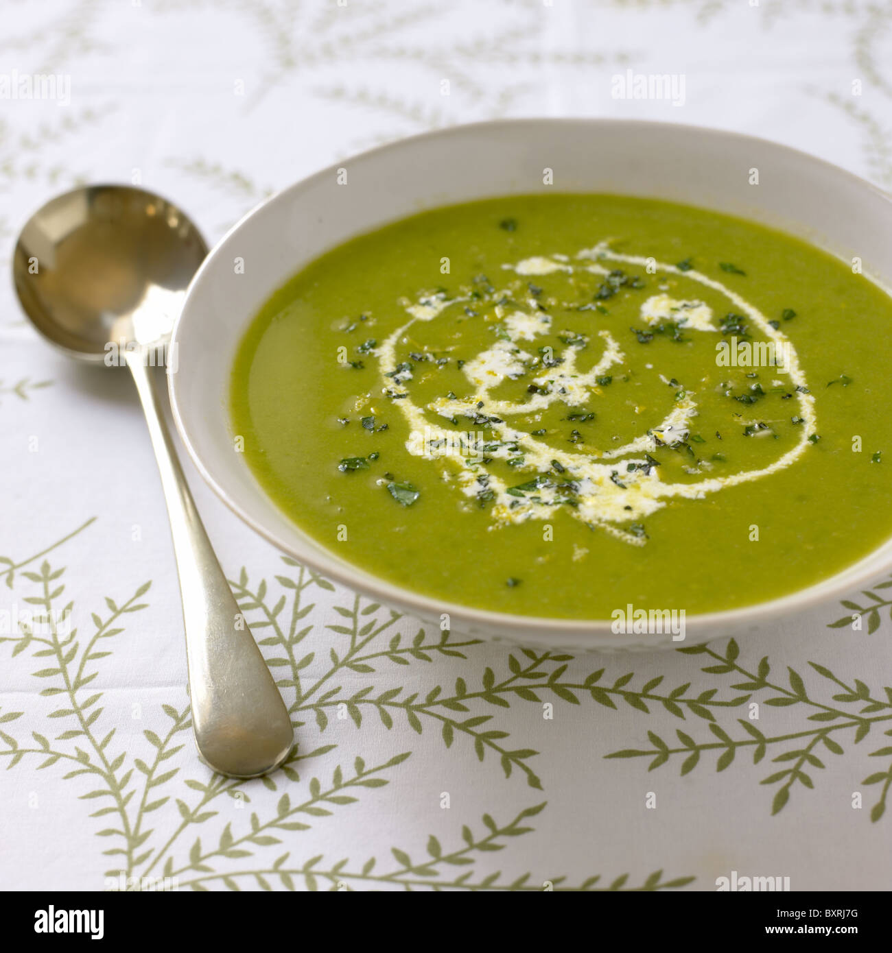 Pea soup with mint gremolata - Stock Image