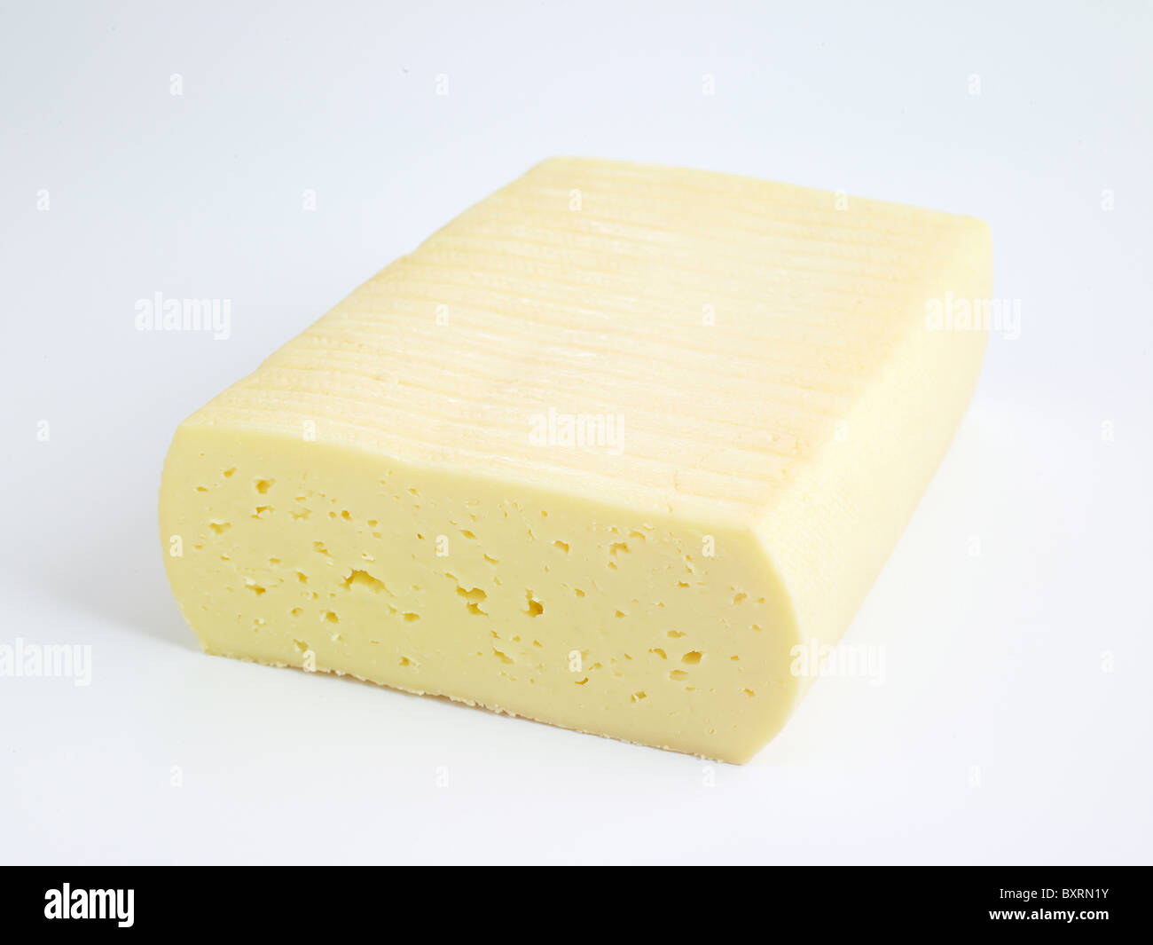 Danish Esrom cheese against white background - Stock Image