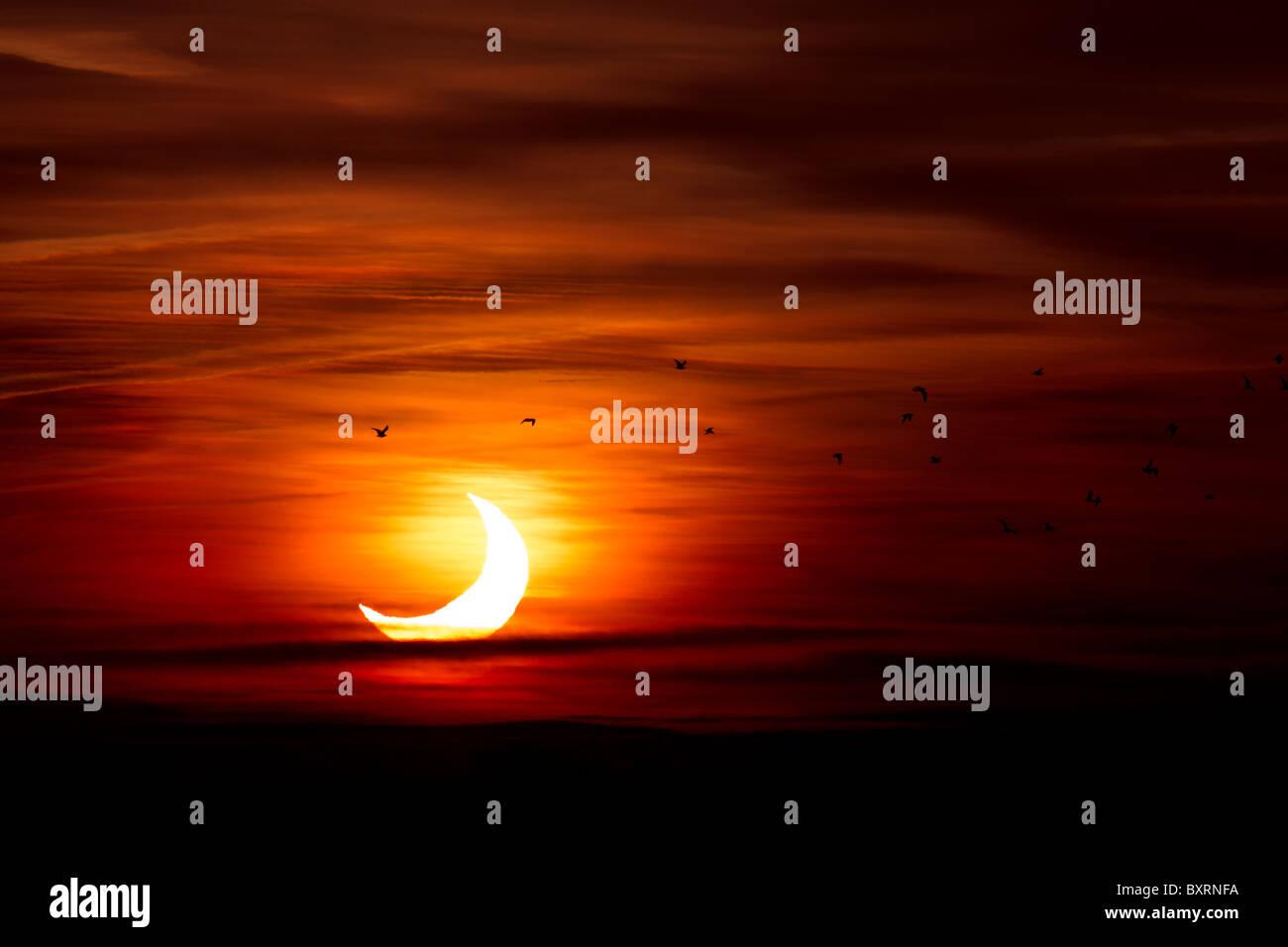 Partial Solar Eclipse in Cambridgeshire UK 4th January 2011 at Sunrise - Stock Image