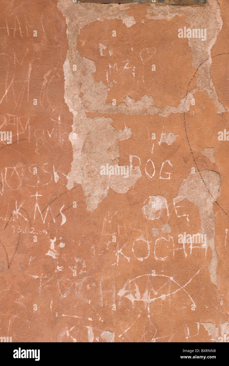 Vandalism on old wall grungy - Stock Image