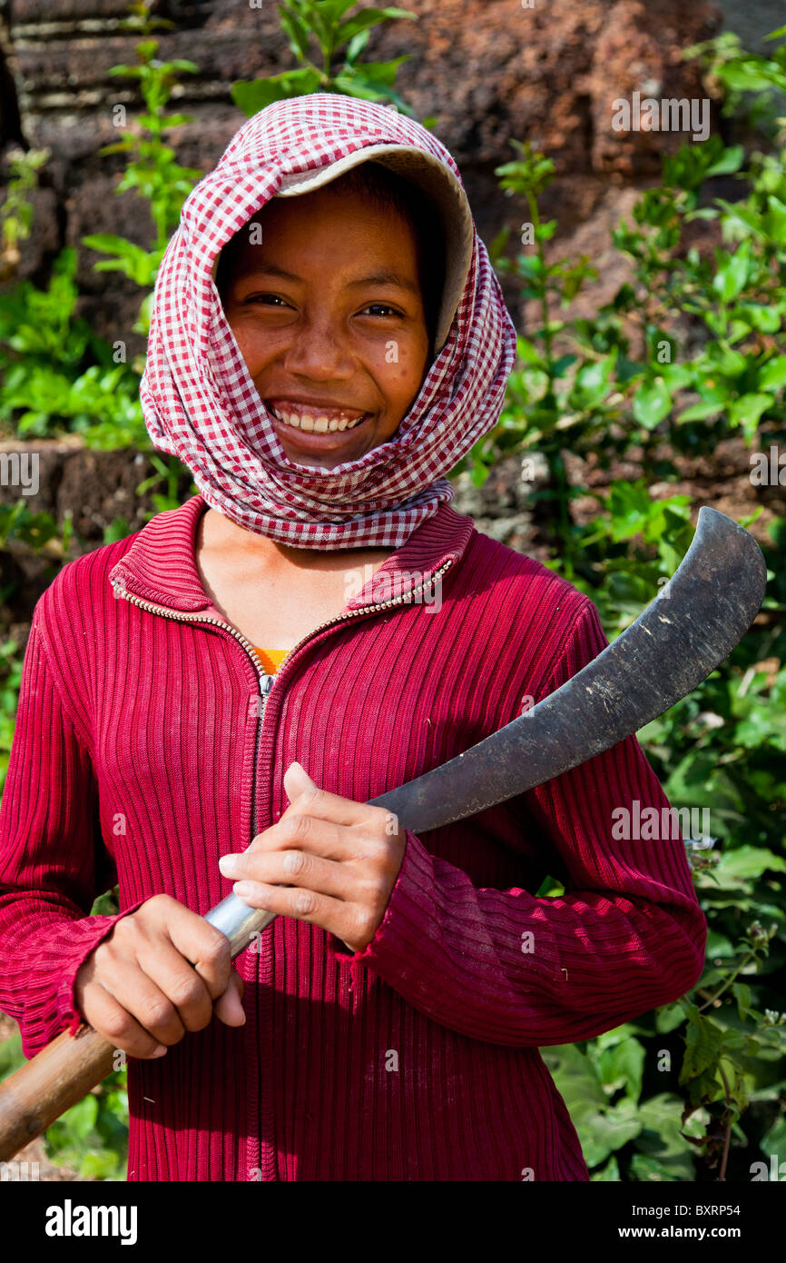 portrait-of-a-khmer-girl-with-krama-and-machete-takeo-province-cambodia-BXRP54.jpg