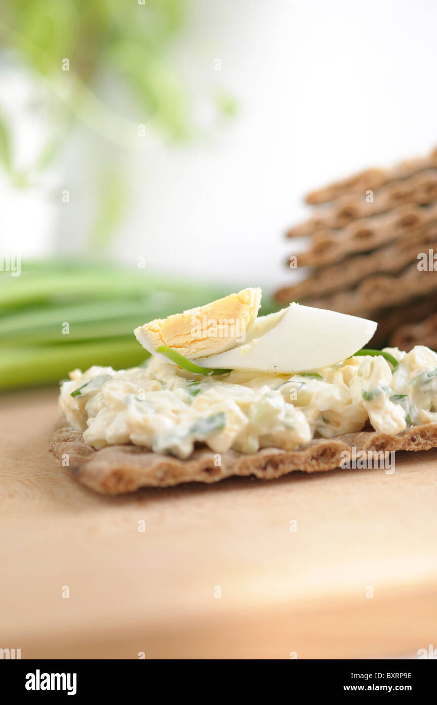 Egg Pasta with chives on a Dark Thin Diet Bread Stock Photo