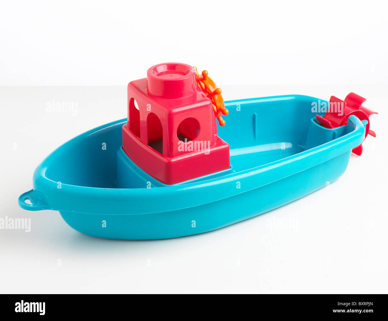 Plastic blue toy boat - Stock Image