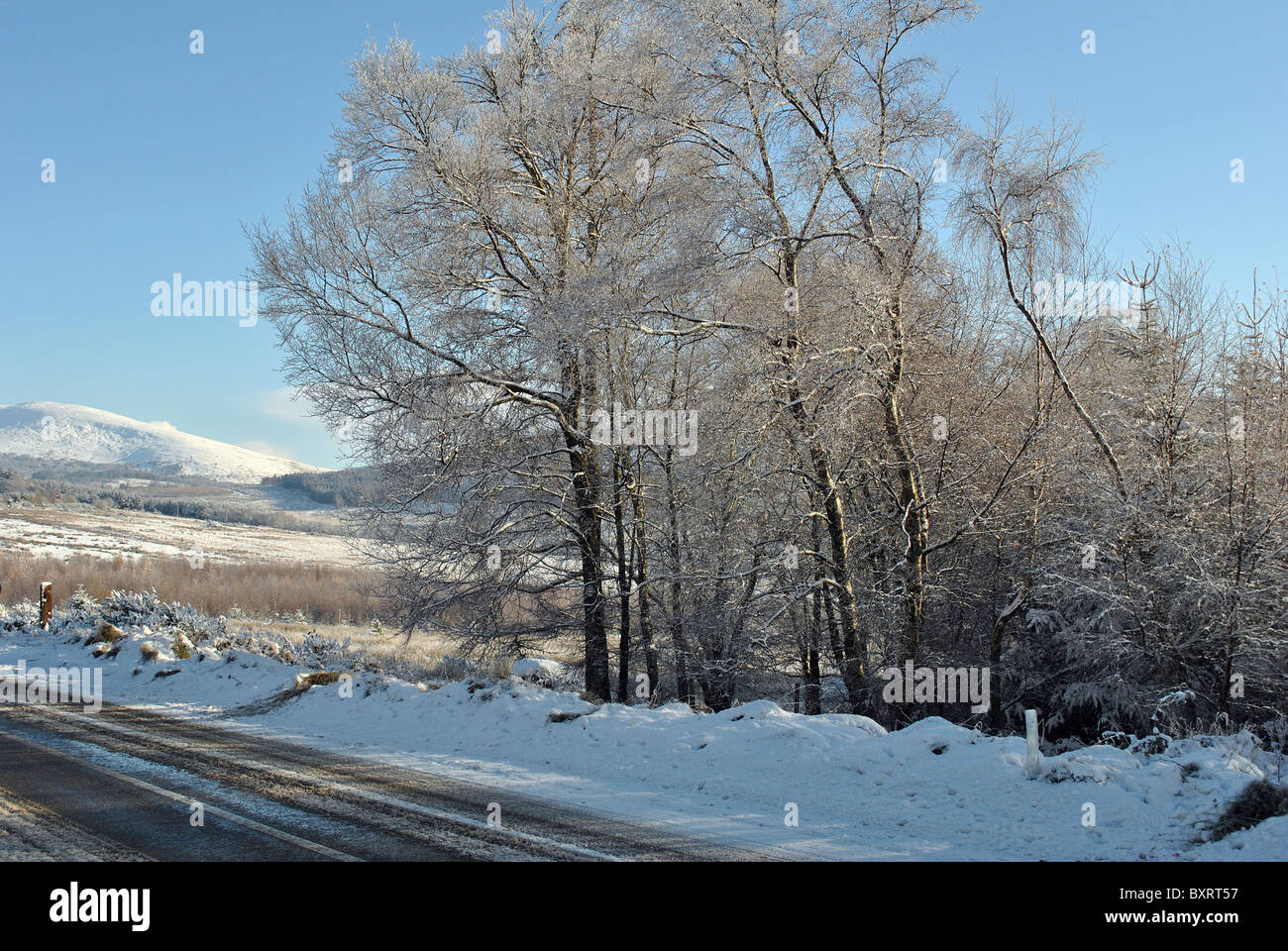 slippery road conditions on the wicklow gap in wicklow ireland - Stock Image