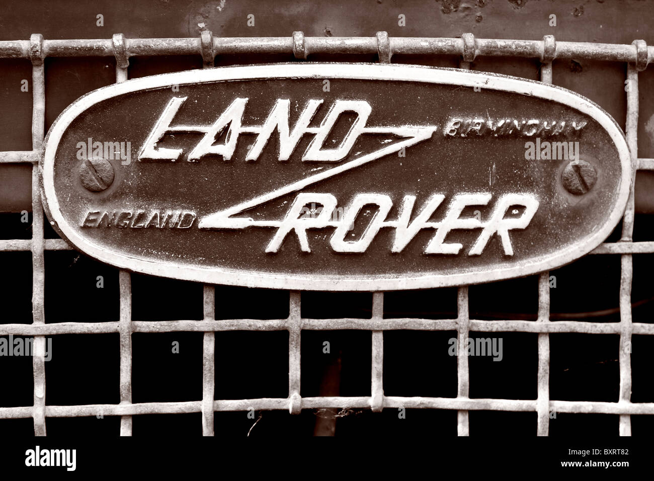 The Land Rover front logo badge on a grill of a vehicle. - Stock Image