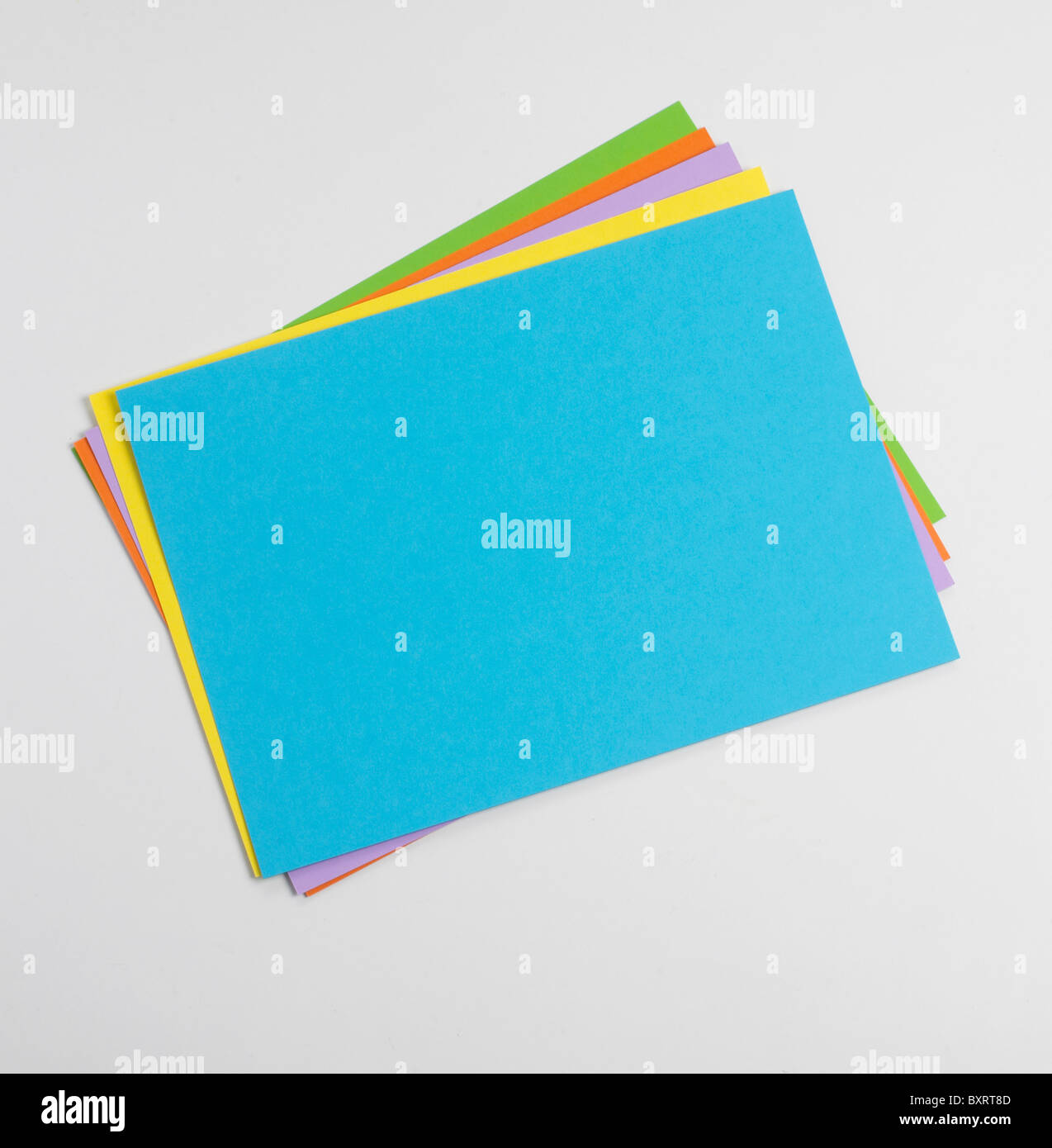 Brightly coloured sheets of paper - Stock Image