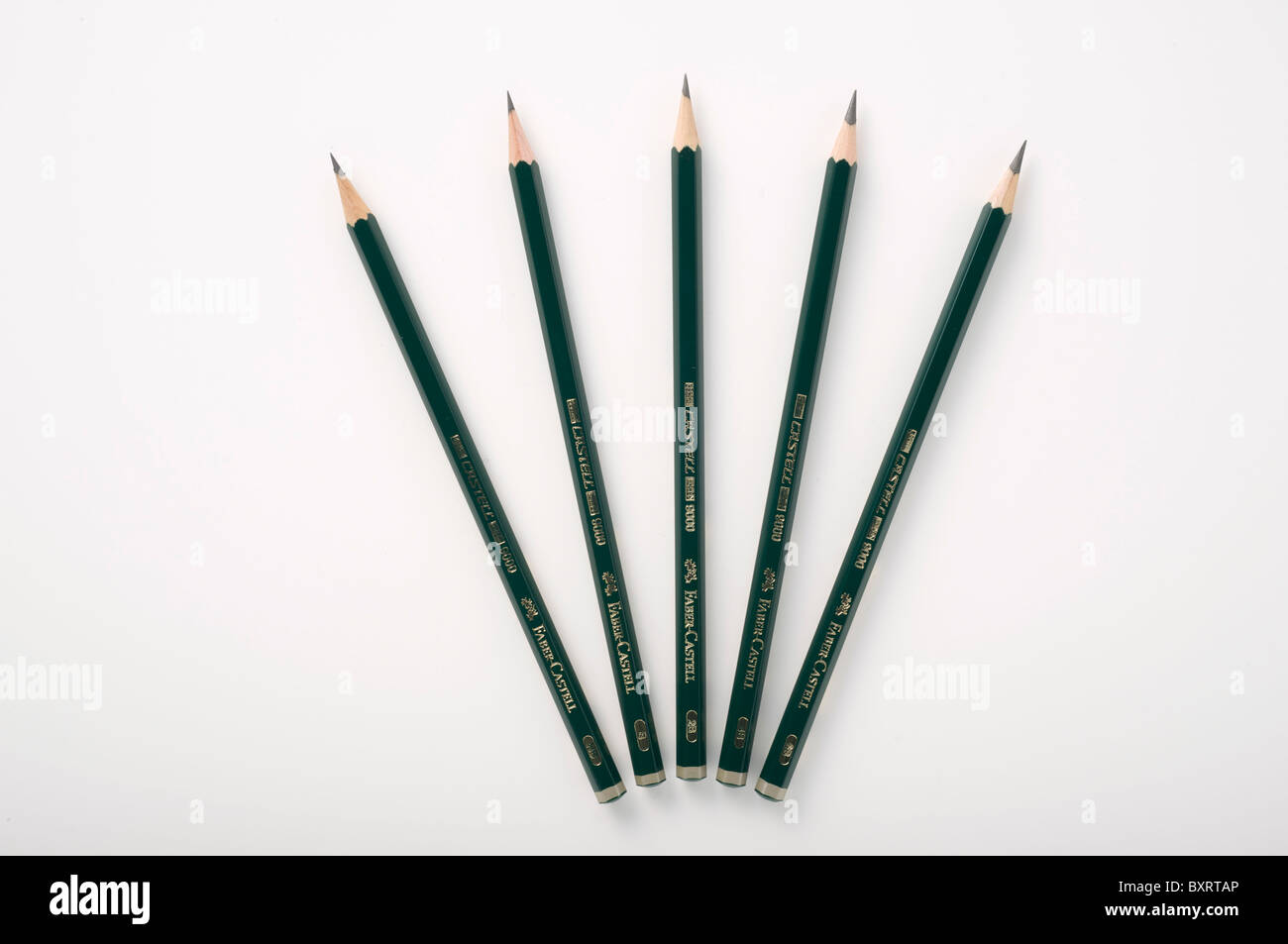 Five sketching pencils on white background - Stock Image