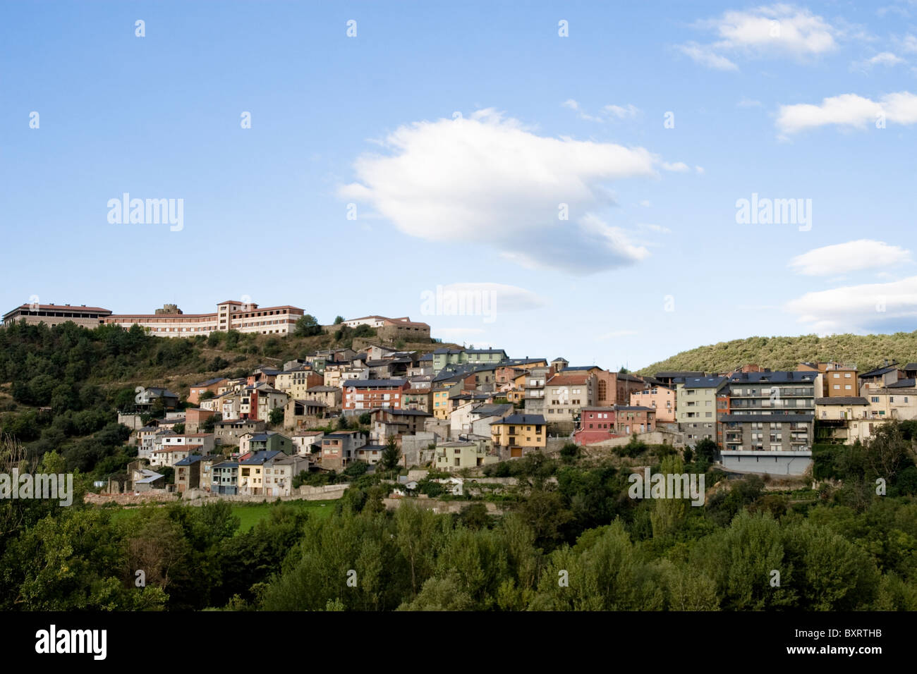 Spain, Catalan Pyrenees, La Seu d'Urgell, View of clouds above village - Stock Image