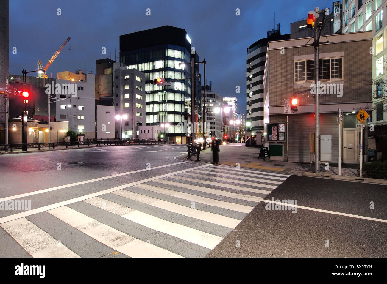 Zebra Crossing at night in a deserted district of downtown Tokyo Japan - Stock Image