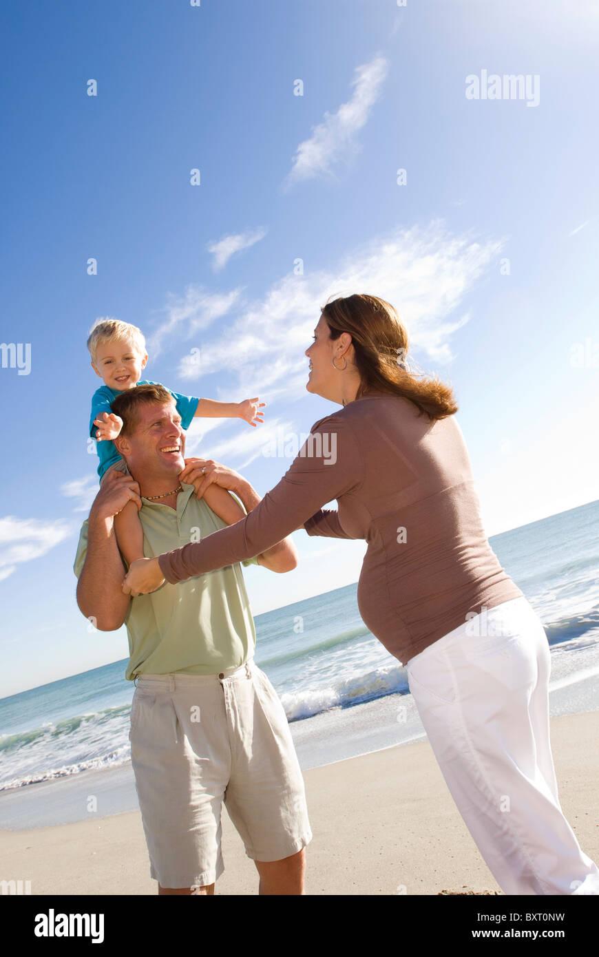 family of 3 at beach Stock Photo
