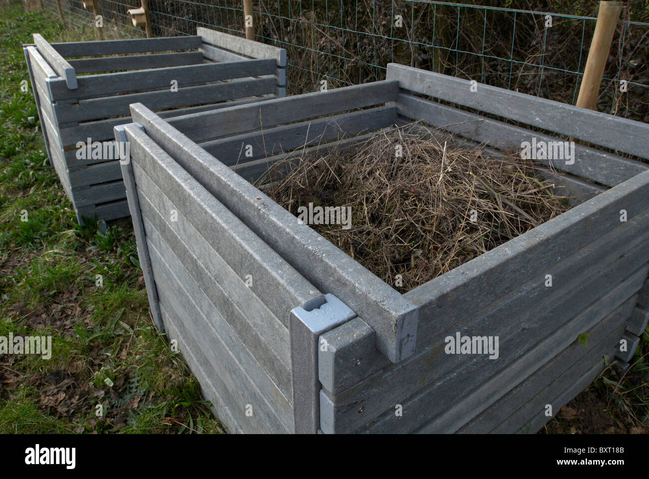 Recycled plastic compost bins - Stock Image