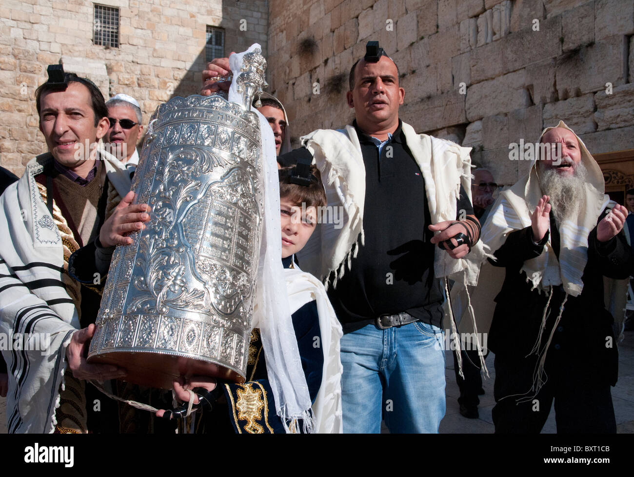 Western Wall. youngster carrying torah scrolls on his bar mitzvah ceremony. Jerusalem Old City - Stock Image