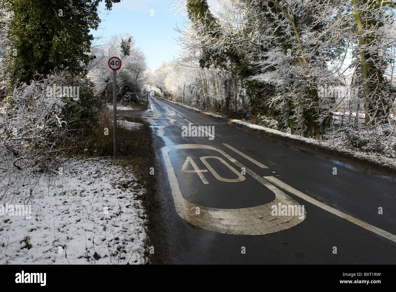 Speed limit sign on road in winter UK - Stock Image