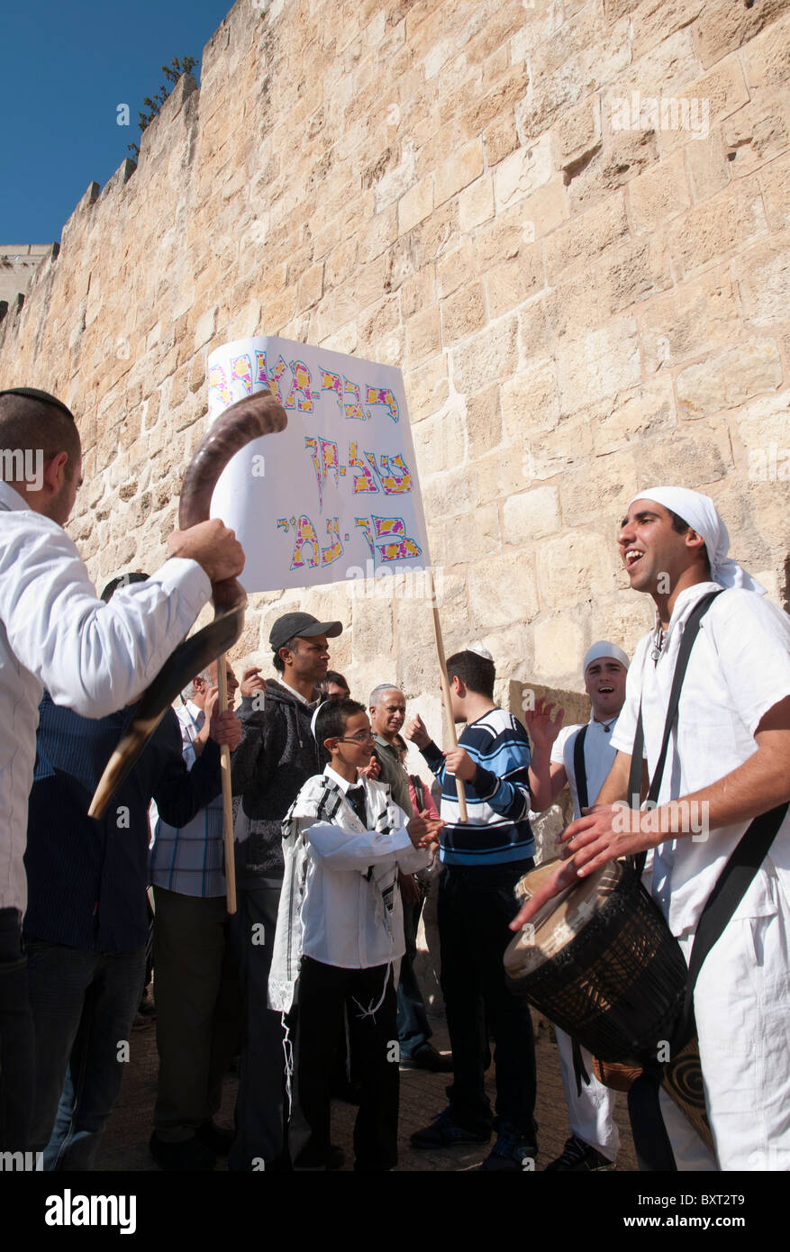 Drummers accompanying a youngster to his bar Mitzvah ceremony by city walls. Jerusalem Old City - Stock Image