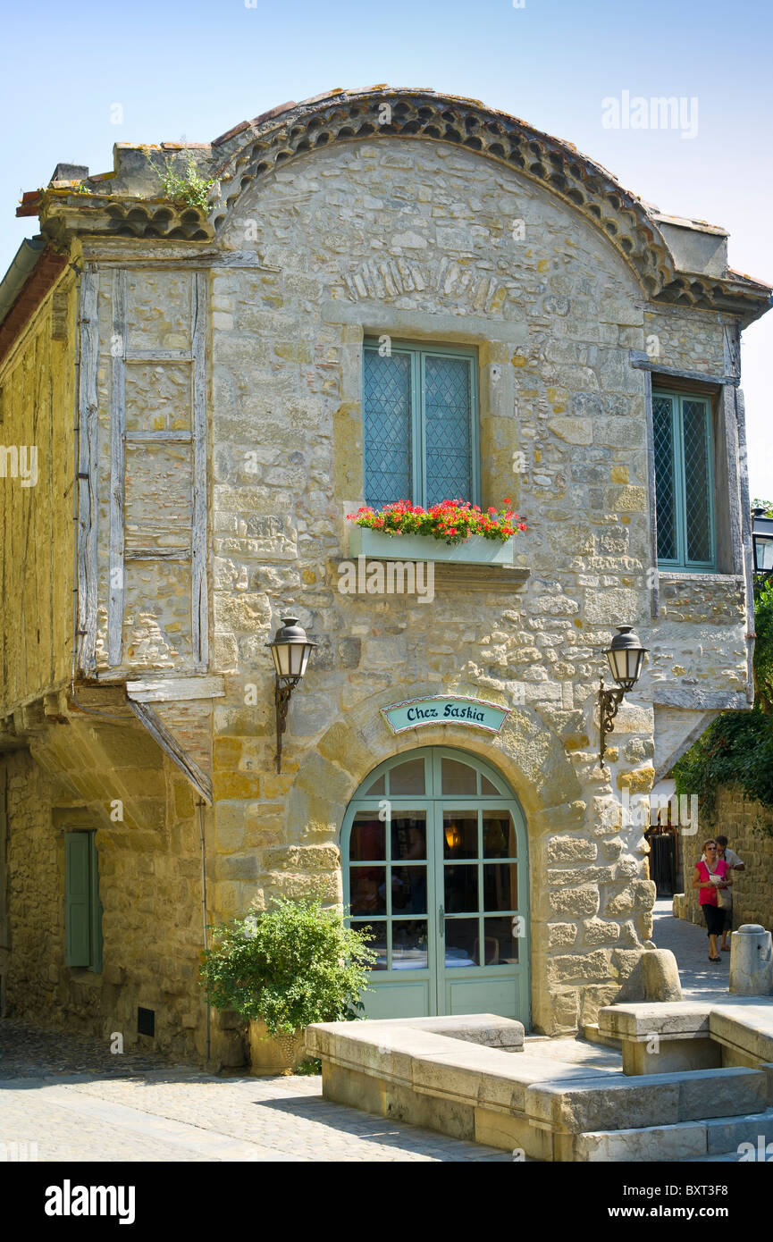 Old Building in Fortified City of Carcassone in use as Restaurant Chez Saskia - Stock Image