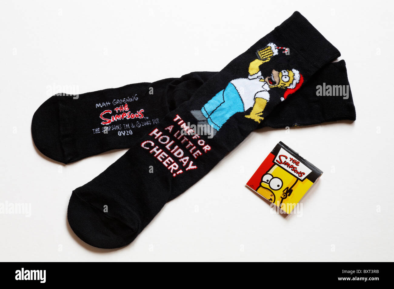 The Simpsons socks - Pair of novelty Homer Simpson socks time for a little holiday cheer isolated on white background Stock Photo