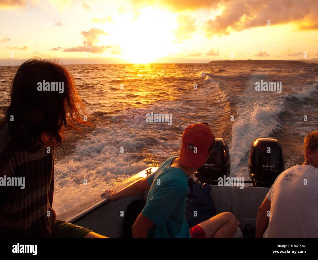Sunrise boat ride along Na Pali coastline, Kauai's North Shore Stock Photo