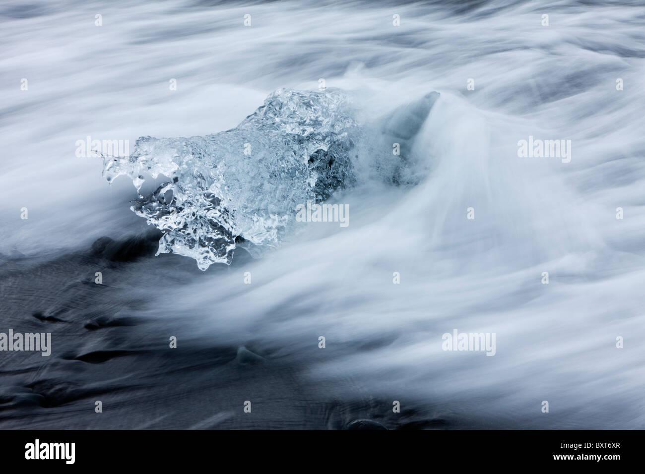 Iceland Skaftafell National Park Motion blur image of icebergs from Vatnajokull Glacier in waves from North Atlantic - Stock Image